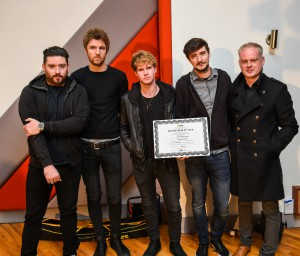 Kodaline's Jason Boland reveives his certificate from Keith Johnson of IMRO making him the 10,000th member of the Irish Music Rights Organisation.