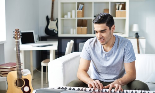 Young musician writing songs at studio